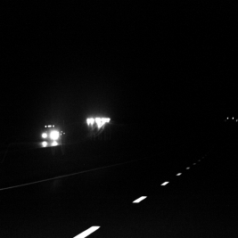 high contrast of headlights on an interstate at night