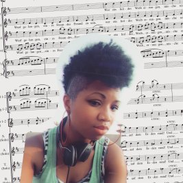 Black woman afro mohawk and sheet music