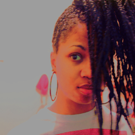 Black woman's head with braids falling over face