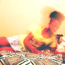 blurry picture of black woman on a bed