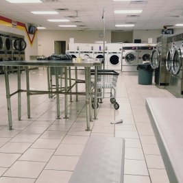 laundromat with dryers and washing machines