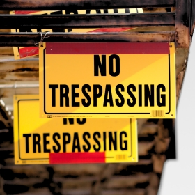 hanging signs that say no trespassing