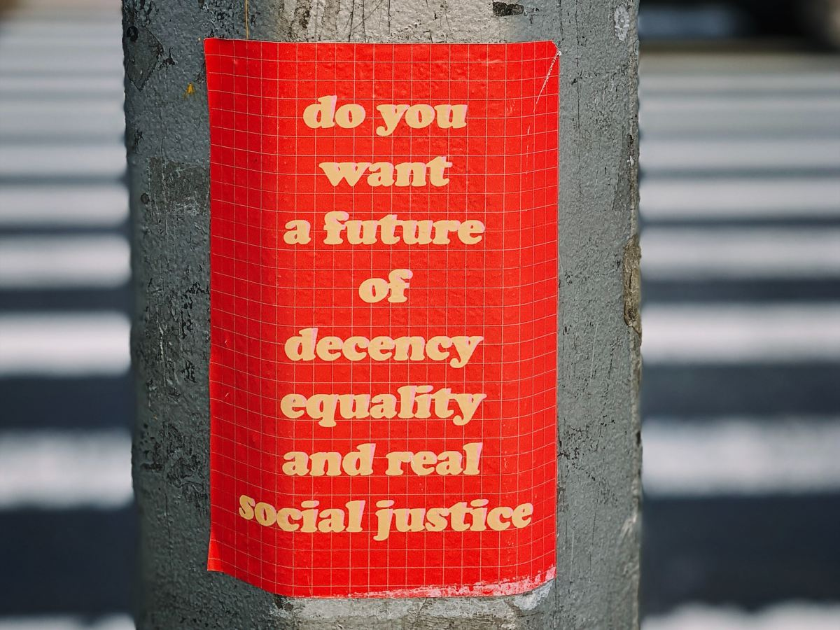 "sign reading ""do you want a future of decency equality and real social justice"""