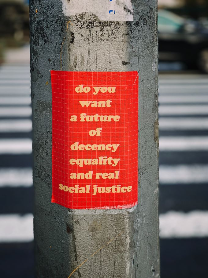 """sign reading """"do you want a future of decency equality and real social justice"""""""
