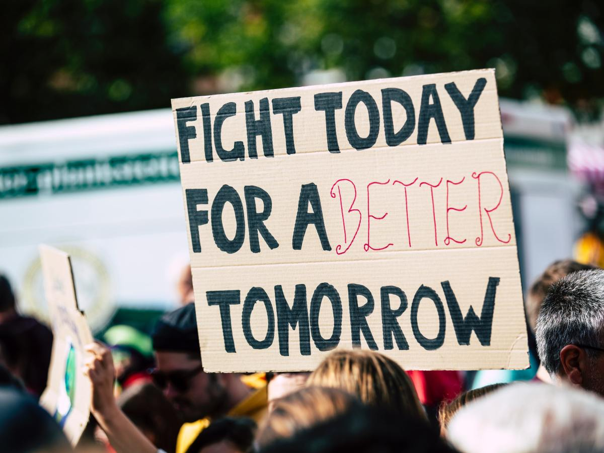 "cardboard protest sign reading ""fight today for a better tomorrow"""