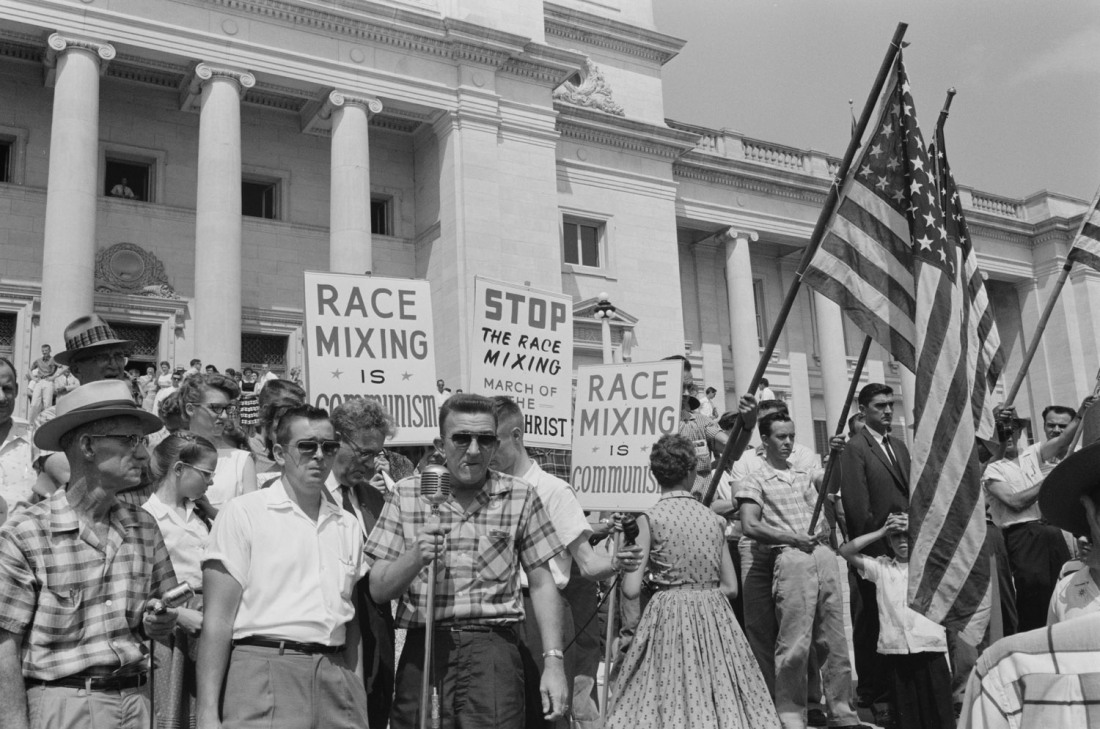 black and white photo of white crowd at Little Rock protest against integration in 1959